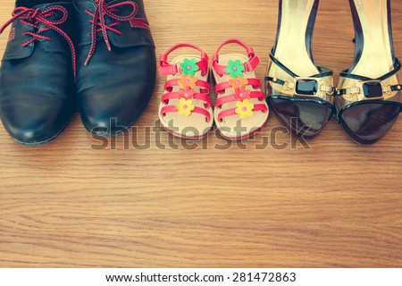 Three pairs of shoes: men, women and children. Shoes parents  and daughters. - stock photo