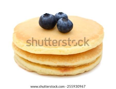 three pancakes and three blueberries on white background  - stock photo