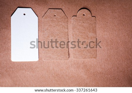 Three paper lable of different shape on craft paper background vintage toned grungy looking design - stock photo