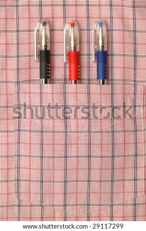 Three pens in the pocket of shirt - stock photo