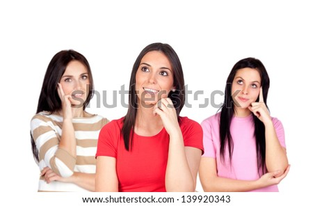 Three pensive brunette girl isolated on a over red background - stock photo
