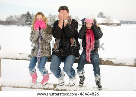 three people in snow showing speak, see and hear no evil - stock photo