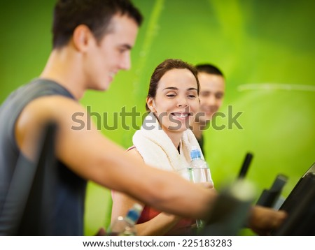 Three people training at the fitness club - stock photo
