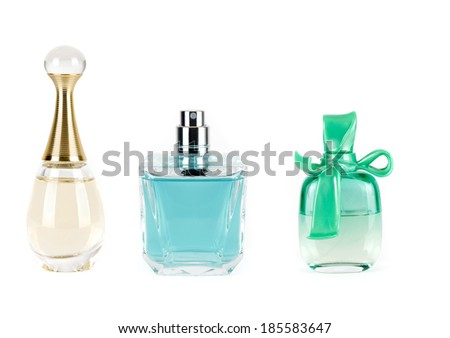 three perfumes in bottles - stock photo