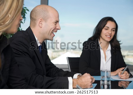 Three persons having fun during brainstorming in blackroom - stock photo