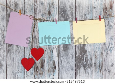 three photo paper attach to rope with clothes pins on wooden background -2 - stock photo
