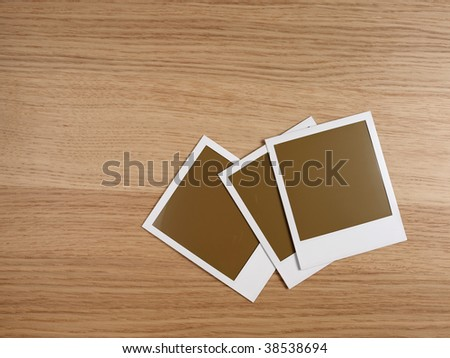 three photos on wooden desktop - stock photo