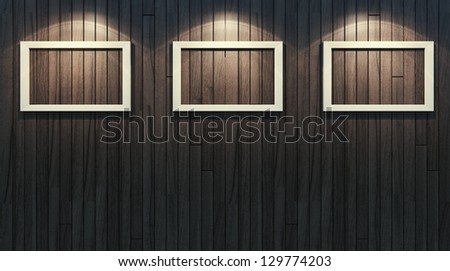 Three picture frames on wooden wall - stock photo