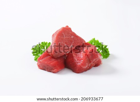 three pieces of beef meat decorated with parsley - stock photo