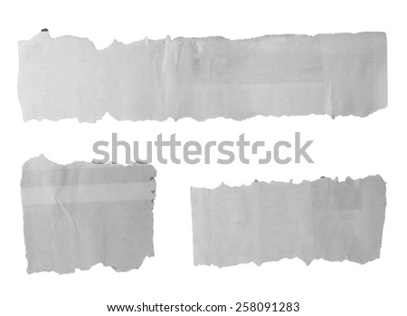 Three pieces of torn paper on plain background - stock photo
