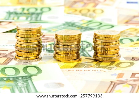 three piles of coins, symbolic photo for financial planning, investment and interest income - stock photo