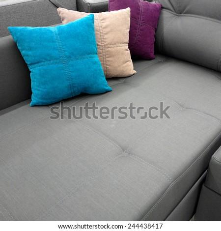 Three pillows on a sofa. - stock photo