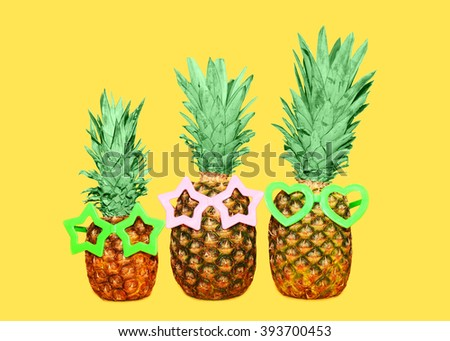 Three pineapple and sunglasses on yellow background, colorful ananas photo - stock photo