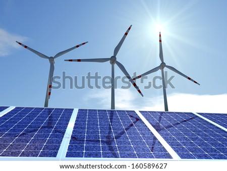 three pinwheels behind solar panels - stock photo