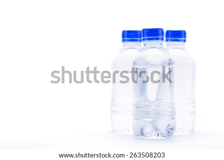 Three plastic bottle of drinking water isolated on white background - stock photo
