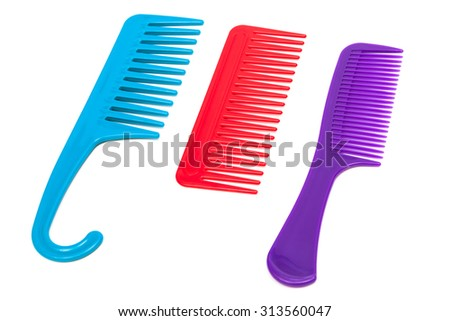 three plastic comb on a white background - stock photo