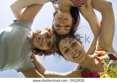 three playmates on the blue sky - stock photo