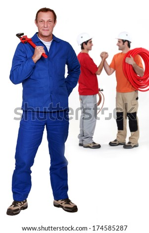 Three plumbers - stock photo
