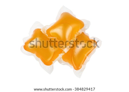 Three pods of washing detergent isolated on a white background with clipping path included. - stock photo