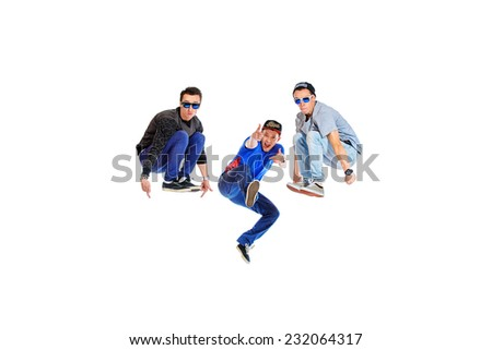 Three professional dancers dancing hip-hop at studio. Isolated over white. - stock photo