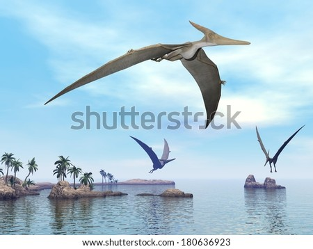 Three pteranodon dinosaurs flying upon landscape with hills, palm trees and water in cloudy sunset sky - stock photo
