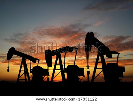 Three pumps over orange sky - stock photo