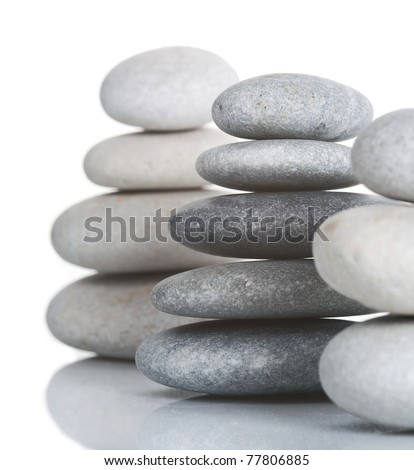 Three pyramids of stones isolated on white - stock photo