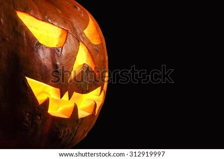Three quarter view spooky halloween pumpkin Jack O Lantern shiny inside isolated - stock photo