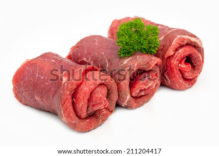 Three raw beef olives  isolated on white background - stock photo