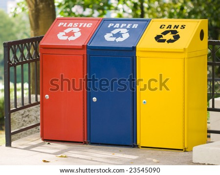 Three recycling bin for cans, plastic and paper. Environmental protection - stock photo