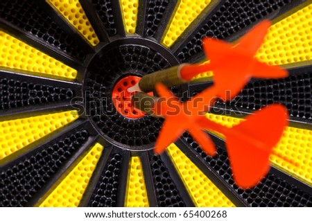 Three red arrows hitting bulls eye - stock photo