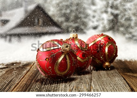 three red balls on gray wooden board  - stock photo