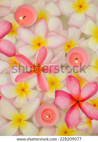 Three red candle and frangipani Background - stock photo