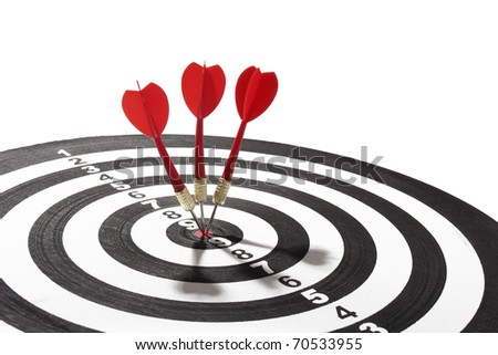 three red darts on target - stock photo