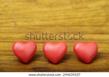 Three red heart on wooden background for valentine's day or greeting card - stock photo