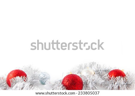 Three red new year balls and silver decoration. Christmas card - stock photo