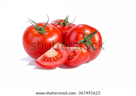 Three red ripe tomatoes and two quarters isolated on a white background - stock photo