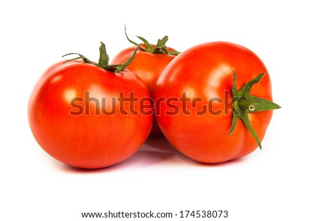 Three red tomatos isolated on white background - stock photo
