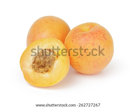 three ripe apricot fruits one half sliced isolated - stock photo