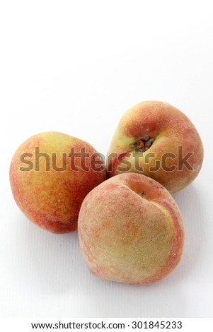 Three Ripe peaches fruit isolated on white background, cutout - stock photo