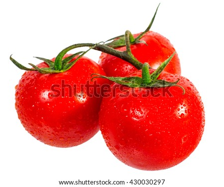 Three ripe, red, juicy tomatoes with water drops are on a white background isolated. Close-up - stock photo