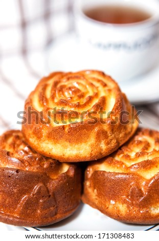 Three rose shape cupcakes on the plate - stock photo
