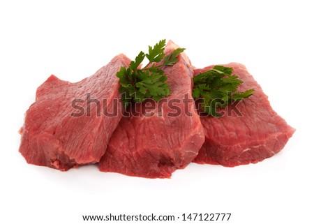 Three round steaks on a white background  - stock photo