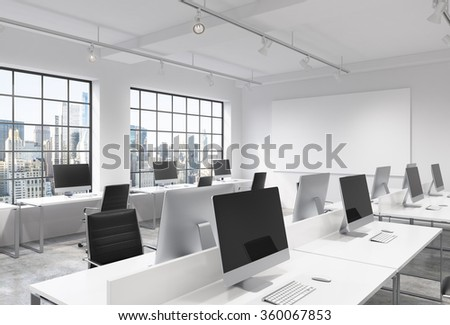 Three rows of computer tables in a light modern open space office, one of them along the window. Big blank screen on the wall. New York view. Concept of work. - stock photo
