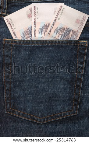 Three russian banknotes in back pocket of jeans - stock photo