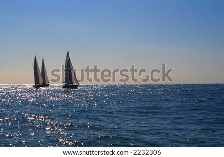 Three sailboats in a sailing race. - stock photo