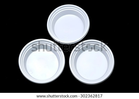 Three sauce Cup on black backgrounds - stock photo