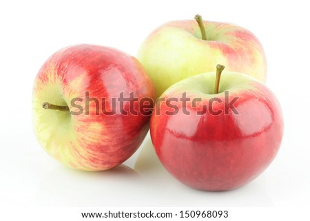 Three shiny fresh red Elstar apple (Malus domestica), on a white background. - stock photo
