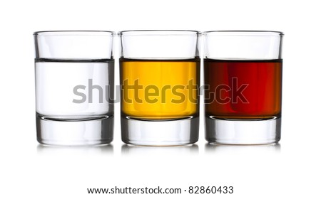 Three shots with liqueur - stock photo