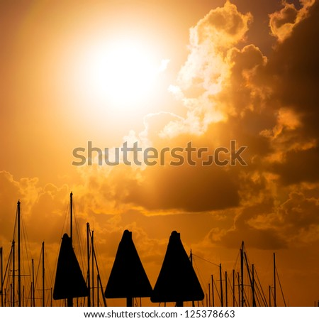 three signal silhouettes at sunset - stock photo